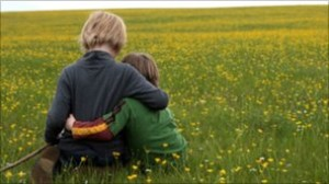 Children Sat Together | Field of Grass | Family Law Company