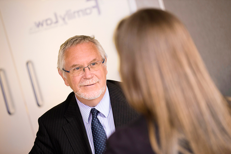 Home page image featuring one of our divorce lawyers speaking to a client.