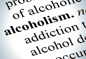 """Close of up the word """"alcoholism"""" to illustrate how our team of lawyers can help parents battling addiction."""