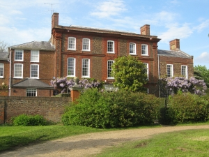 A lovely image of a family home to illustrate property buyouts