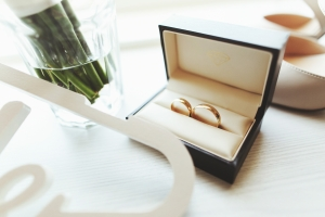 A male and females wedding ring in a box - used to illustrate a blog about What you need to know about Pre-Nuptial Agreements